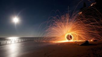 Beach night sparks time lapse wallpaper