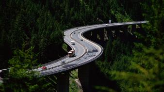Forest cars trucks bridges highway driving Wallpaper