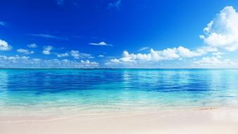 Clouds beach seascapes blue skies wallpaper