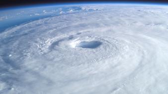 Ocean clouds outer space storm earth hurricane Wallpaper