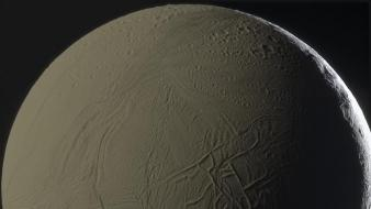Outer space moon shadows enceladus wallpaper