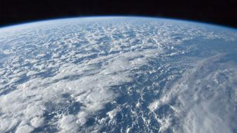 Ocean clouds outer space earth wallpaper