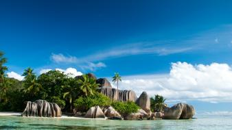 Clouds landscapes nature trees rocks islands seychelles beach wallpaper