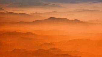 Landscapes nature orange hills fog mist evening wallpaper