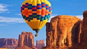 Valley hot air balloons bushes rock formations wallpaper