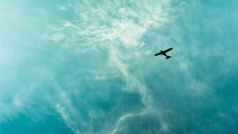 Clouds aircraft silhouette blue skies wallpaper