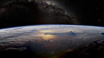 Clouds stars earth atmosphere wallpaper