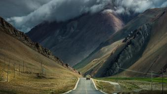 Mountains clouds landscapes nature roads skies Wallpaper