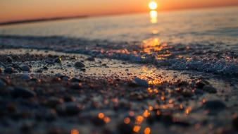 Sunset sand bokeh pebbles seascapes sea shorelines wallpaper