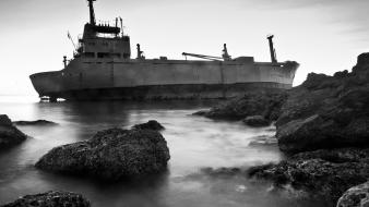 Black and white ships rocks sea wallpaper