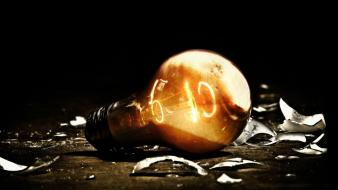 Lit light bulbs wallpaper