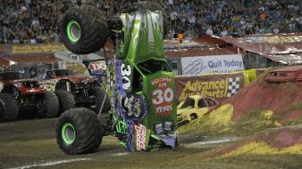 Cars around monster truck grave digger jam wallpaper
