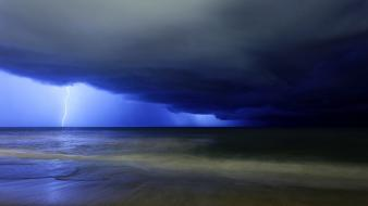 Clouds nature storm overcast lightning seascapes gloomy sea Wallpaper