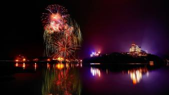 Fireworks nightlights nighttime reflections water body wallpaper
