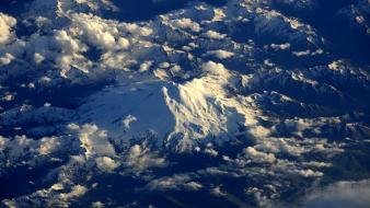 Mountains clouds landscapes snow outer space nasa Wallpaper