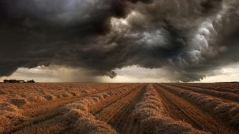 Agriculture black brown dark clouds fields wallpaper