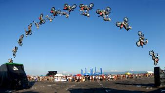 Sports motocross motorbikes multiple exposure wallpaper
