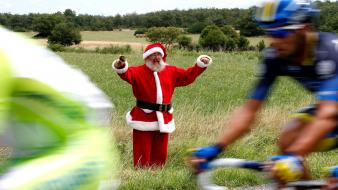 Sports santa claus cycling races hat cycles wallpaper