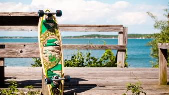 Clouds fences plants skateboards longboard blurred background sea wallpaper