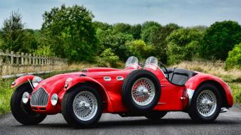 Vintage front angle view car j2 roadster Wallpaper