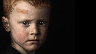 Bandaids black background portraits children wallpaper