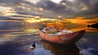 Water sunset clouds animals orange boats vehicles skies wallpaper