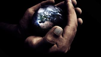 Earth black background hands wallpaper