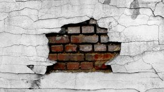 Wall holes bricks broken wallpaper