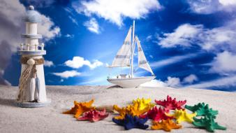 Clouds lighthouses miniature multicolor sailboats wallpaper