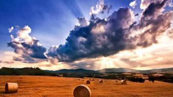 Mountains clouds landscapes nature fields sun rays wallpaper
