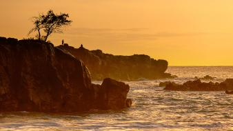Sunset silhouettes hawaii cliffs sea Wallpaper