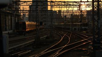 Sunset trains buildings railroad tracks cities wallpaper