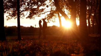 Sunset trees forests silhouettes couple sunlight wallpaper