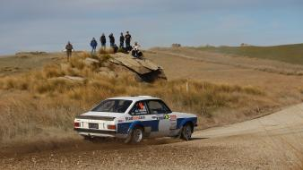 Cars brown rally roads vehicles motorsports gravel Wallpaper