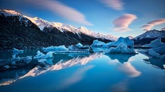 Cold lakes reflections light blue snowy peaks Wallpaper