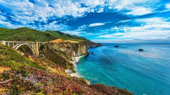 Hills cliffs oceans seaside cove skie beach Wallpaper