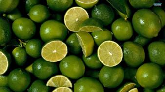 Green fruits limes lemons Wallpaper