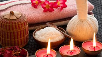 Towels bowls salt flower petals candles wallpaper