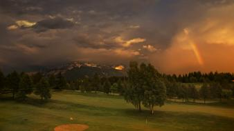 Trees grass rainbows golf course snowy peaks wallpaper