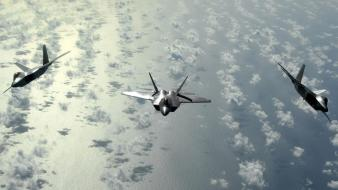 Clouds aircraft army flying f-22 raptor fighter jets Wallpaper