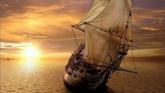Sunset sailing boat wallpaper