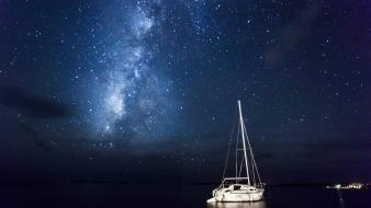 Milky way boats lakes night sky Wallpaper