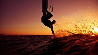 Sunset sports silhouettes surfing splashes sea wallpaper
