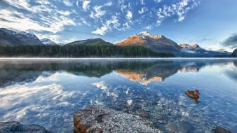 Lakes reflections light blue skies snowy peaks wallpaper