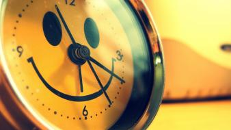 Close-up yellow design funny smiling alarm clocks creative wallpaper