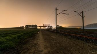 Landscapes night trains railroad tracks roads low light Wallpaper