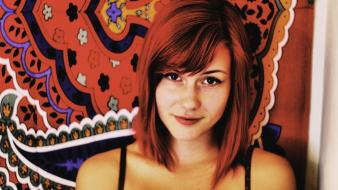 Redheads teen brown eyes carpet smiling shoulders wallpaper