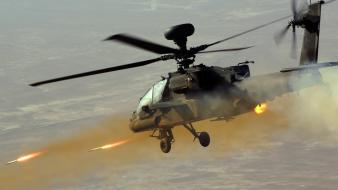 Aircraft army apache military helicopters rockets ah-64 firing Wallpaper
