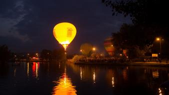 Crowd hot air balloons night rivers wallpaper
