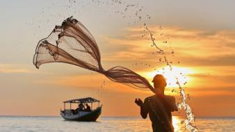Indonesia national geographic sun boats fishermen wallpaper